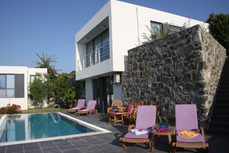Villa and pool, steps lead up to sun terrace off kitchen with views