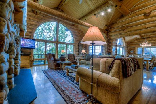 Grand Living Area With Vaulted Ceilings, Wood burning Fireplace, Flat Screen TV