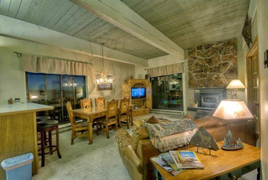 Living and Dining Area with Deck Access Doors, Wood Burning Fireplace, TV, Sleeper Sofa
