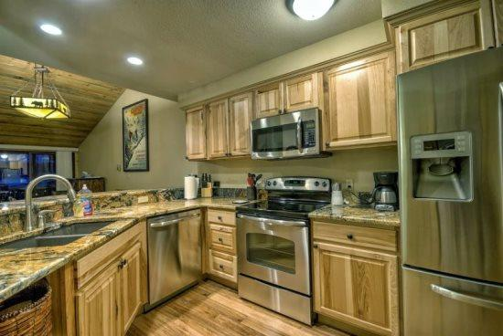 Kitchen with Stainless Appliances, Granite Counter Tops, Open to Living Room