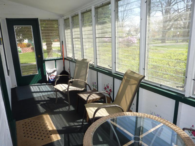Screened porch on Cottage A, with vintage glass louvers that can be opened or closed.