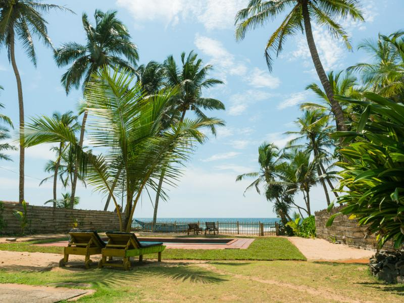 Indian Ocean view from the spacious beachfront garden with swimming pool.