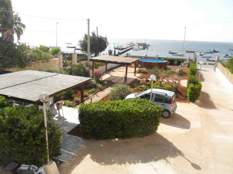 Garden with outdoor swimming pool and sea view