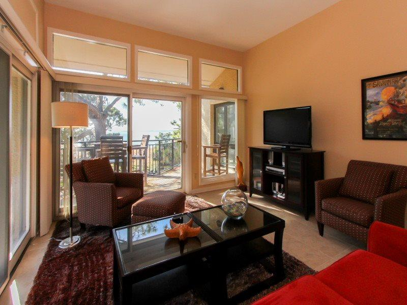 Living Room with Flat Screen at 1877 Beachside Tennis