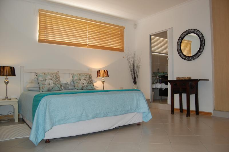 Bedroom with queensize bed and ensuite shower room and TV