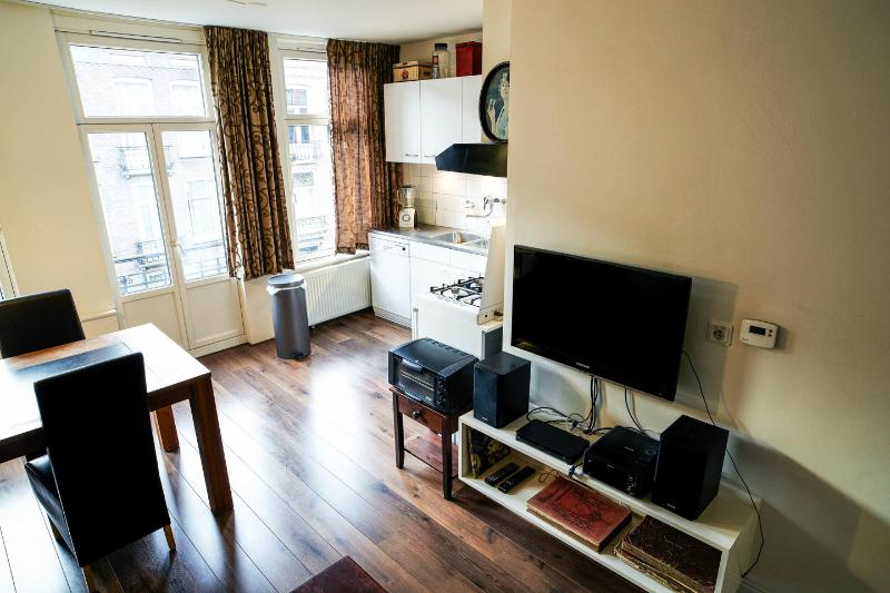 Livingroom with digital TV + musicbox. Kitchen in the corner