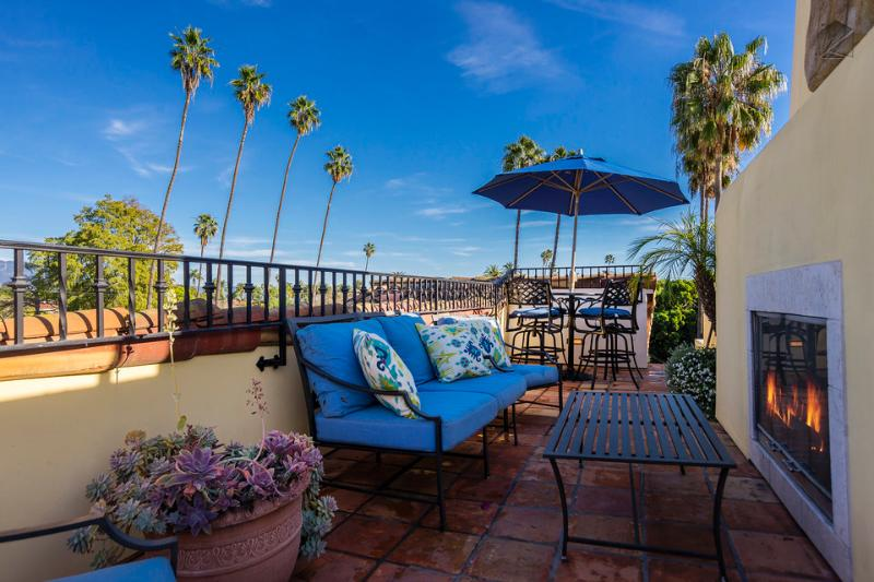 Get some sun and enjoy the mountain view on this rooftop patio on one of these comfortable chairs.