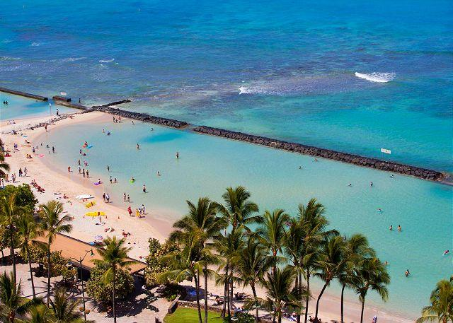Across from Waikiki Beach has a giant seawall, wave-free pool!