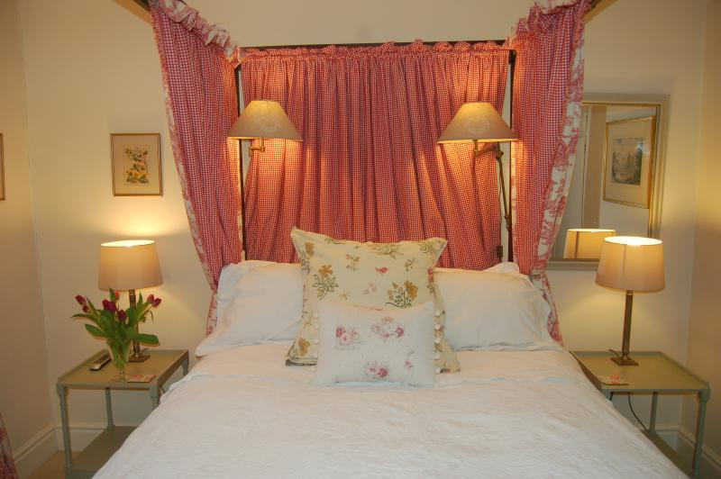 Antique four poster bed with duck down duvet