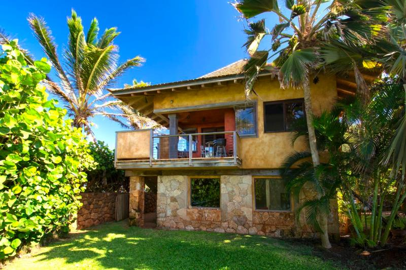 Private upstairs rental with expansive ocean and beach views.