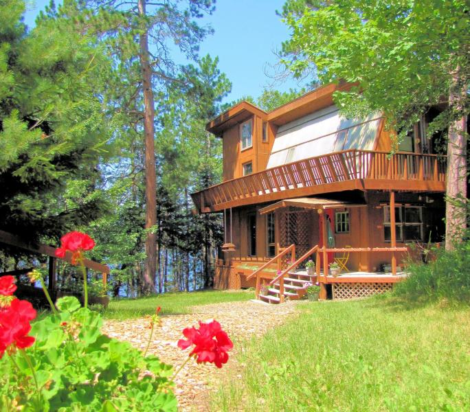 Our lovely sun-bathed lodge on the pine-studded shoreline of White Iron Lake