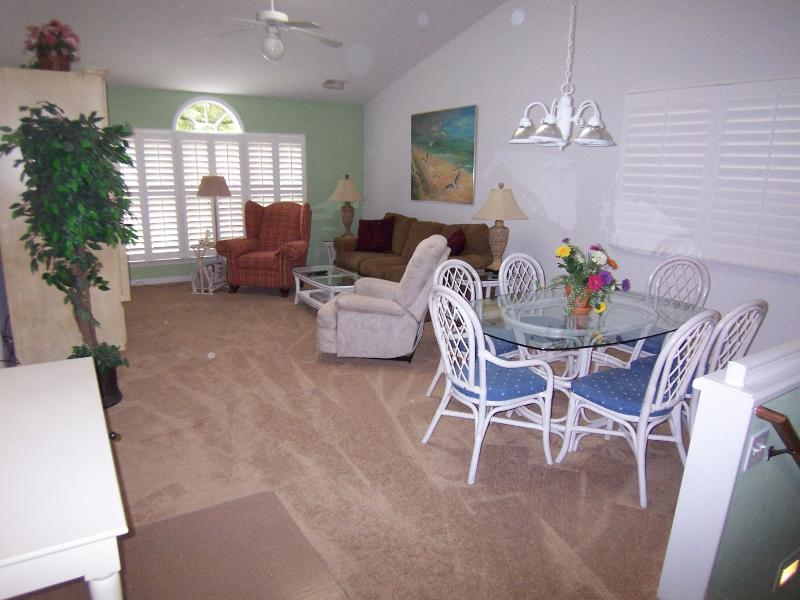 Spacious living/dining area--2 easy chairs, sofa, 37' TV/DVD, on golf course, screened porch.