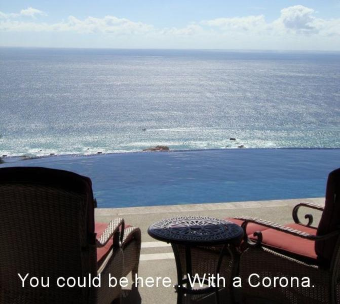 Villa deck view, overlooking infinity pool to ocean. You could be here. With a Corona. And should be