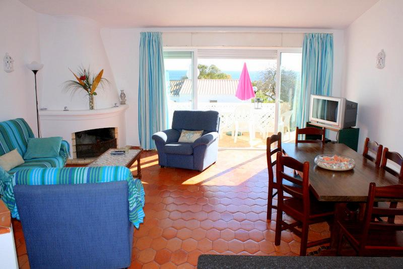 The lovely bright living area has sea views and doors to the upper patio