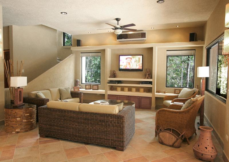 Sink into the comfortable wicker couches and enjoy HBO/Max on the 42 inch TV