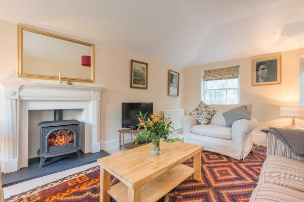 The comfortable and tranquil sitting room has a gas stove