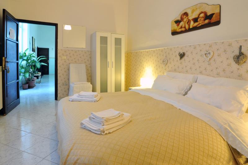 double-bed room with shared bathroom