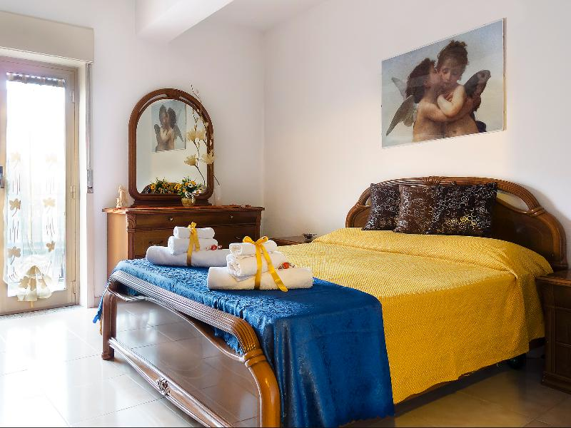 Master bedroom with TV in this comfortable Vacation Apartment  in San Piero Patti, in Sicily, Italy