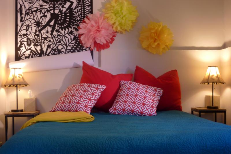 Queen-sized bed in a room full of color!