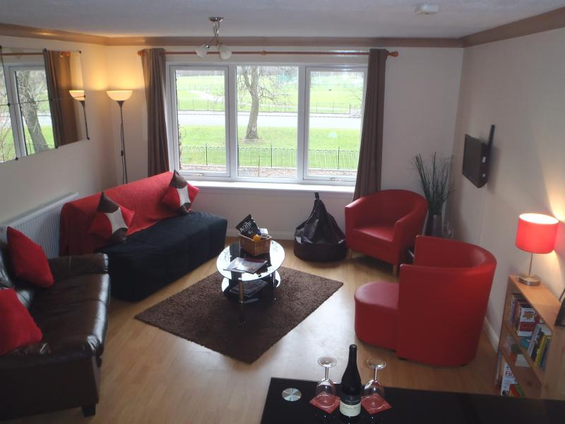 The living room benefits from huge amounts of natural light. Free car parking is directly outside.