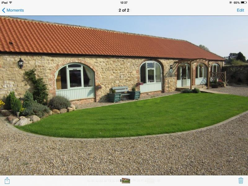 The Cart House, set in a private courtyard along with 3 other holiday cottages.