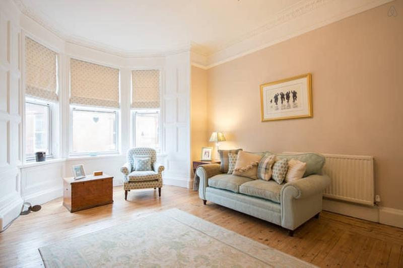 Stylish and spacious sitting room with bay window (partial sea views)