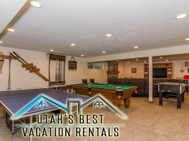 Large basement family rec room with billards, ping pong, foosball, sectional, TV, kitchenette