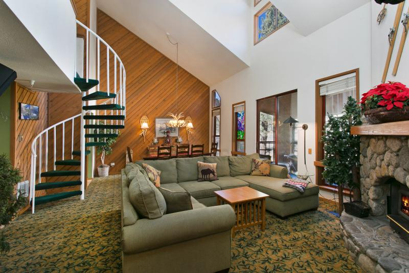 Aspen Creek #228 Living Area With A Wood Burning Fireplace and Vaulted Ceilings