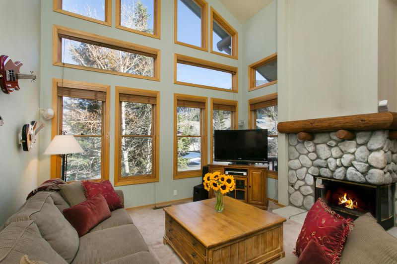 Snowcreek #874 Living Area With A Gas Fireplace And Floor To Ceiling Windows