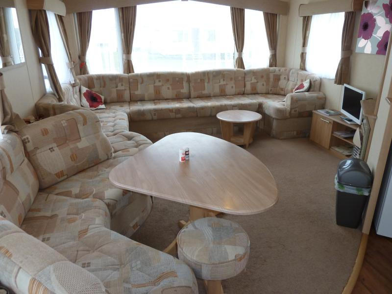 The layout of Poppy showing kitchen to right, table to left and TV/DVD to right. coffee table too