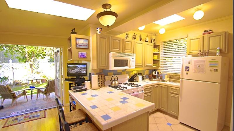 The Cottage's sunny and fully-stocked kitchen, with garden patio