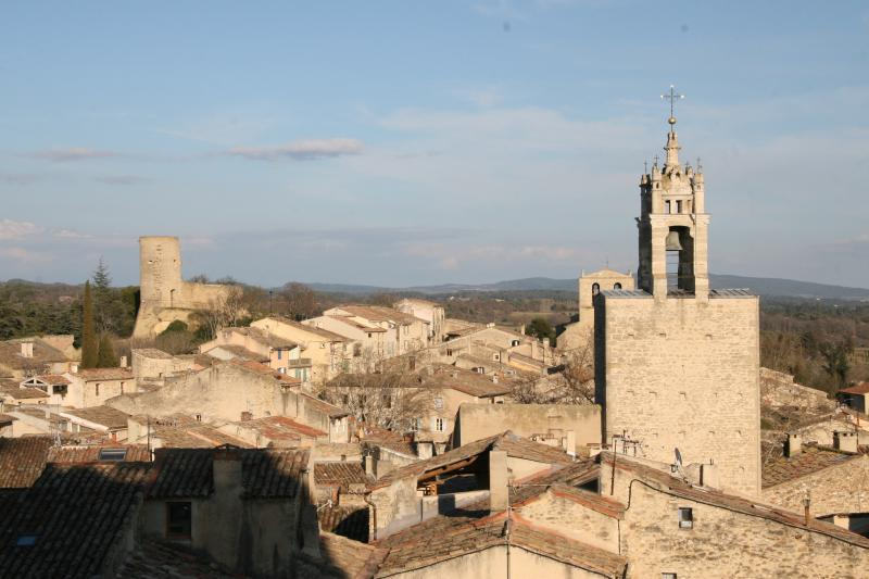 The charming Luberon village of Cucuron, view from the Castle grounds to the clock tower