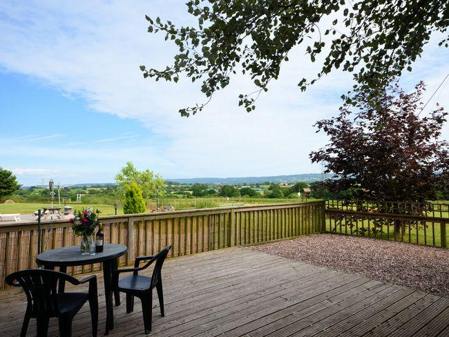 Enclosed decked area with country views
