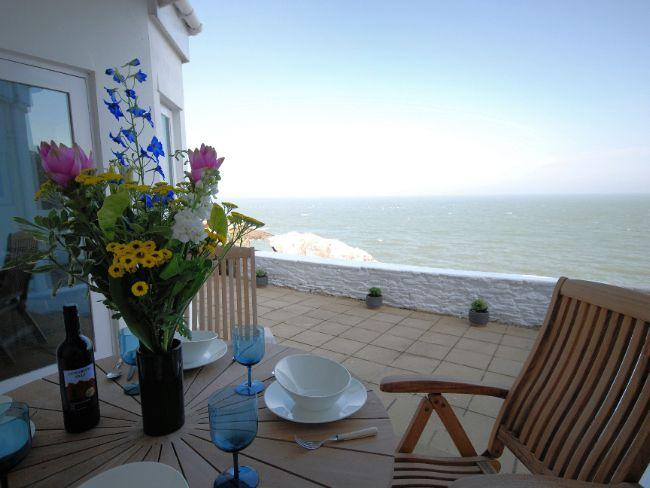 The patio area with seating with fantastic sea views