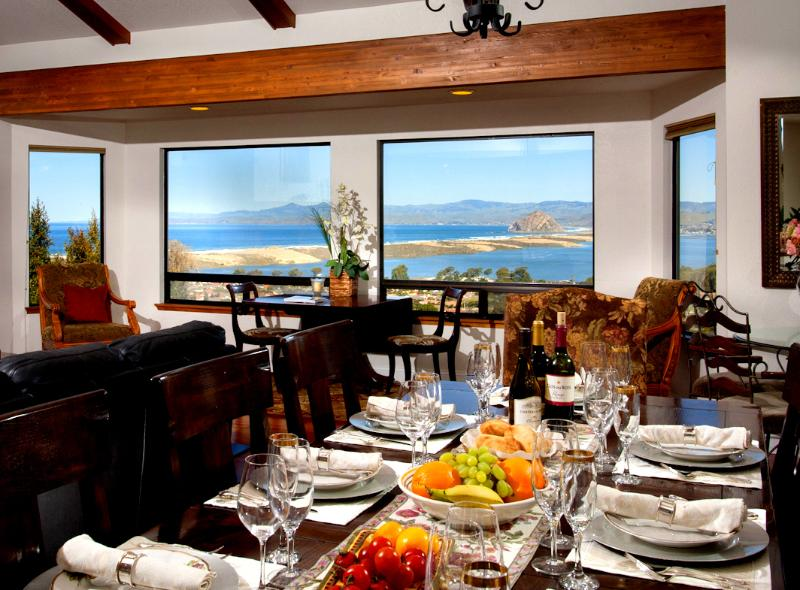Great room is open to dining and kitchen. Table seats 12. Spectacular views from all areas.