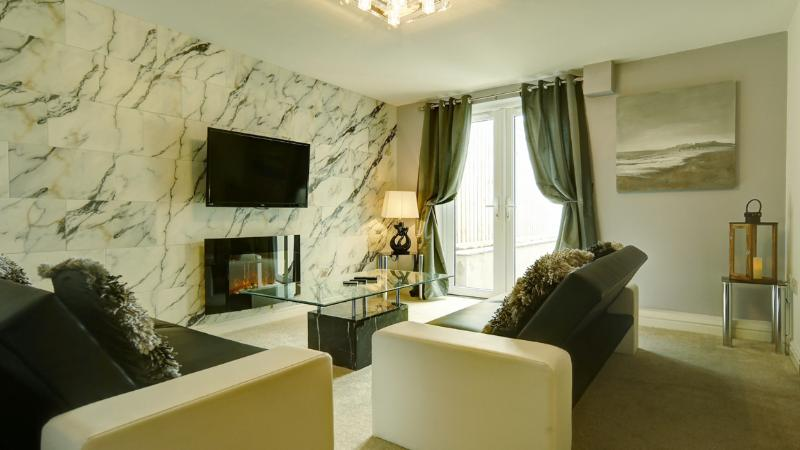 Marble Feature Wall with 42' LCD DVD TV & Fireplace, Leading To An Outside Granite Table & 4 Chairs