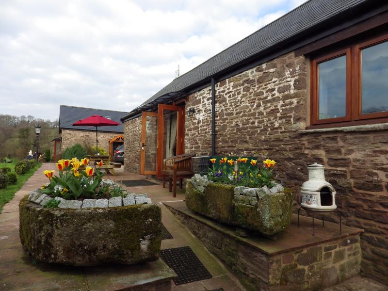 rowan long barn with two ensuite rooms private gardens.