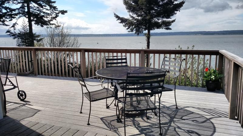 Enjoy the views of Port Susan while relaxing with a drink or eating a meal