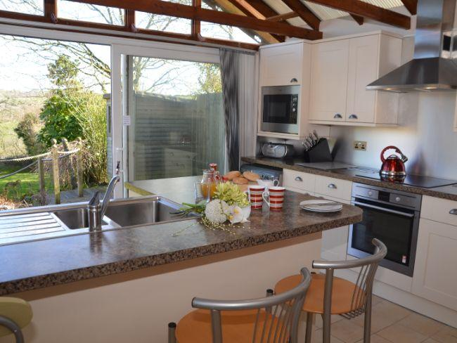 Modern style kitchen with patio doors to decked area