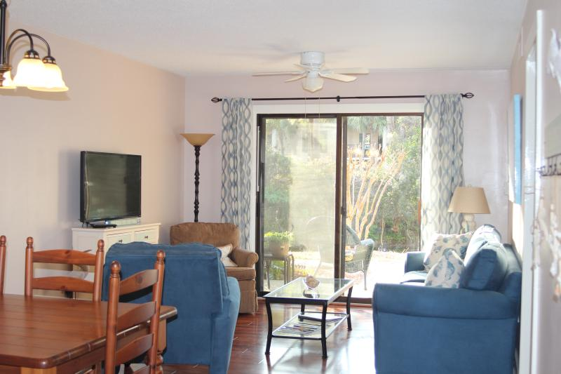 Open living area with 42' smart TV, 200+ channels, Blu Ray/DVD player, WiFi, comfortable seating