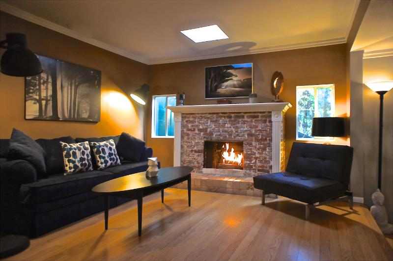 Second Living Area w/ wood burning Fireplace (upstairs)
