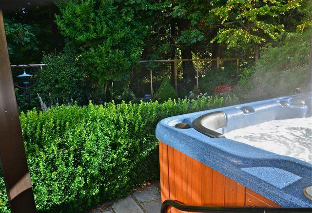 Early morning sunshine greets the hot tub area of the garden first..