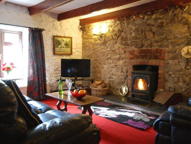 Cosy lounge with woodburner