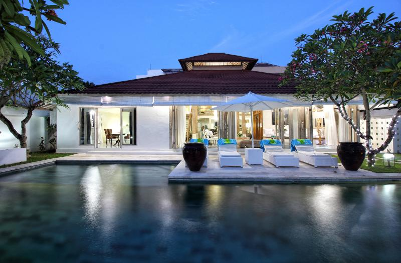 Villa exterior and pool by night
