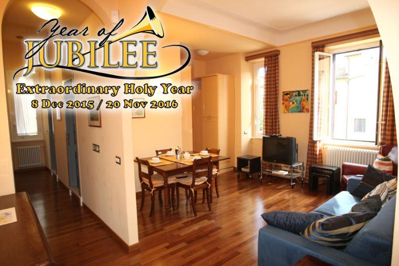 Large living room: 2 windows, sofa, armchair, dining table for 6 persons, Satellite Tv.