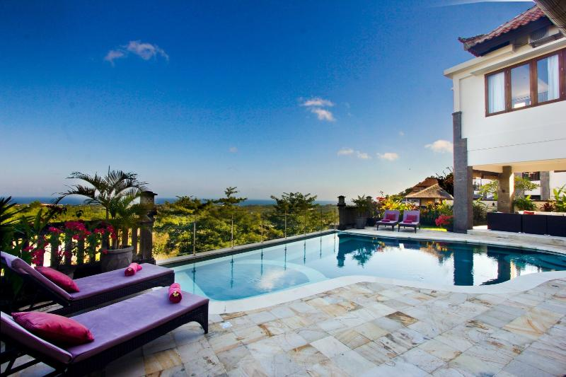 Panoramic sea and sunset views from the infinity pool