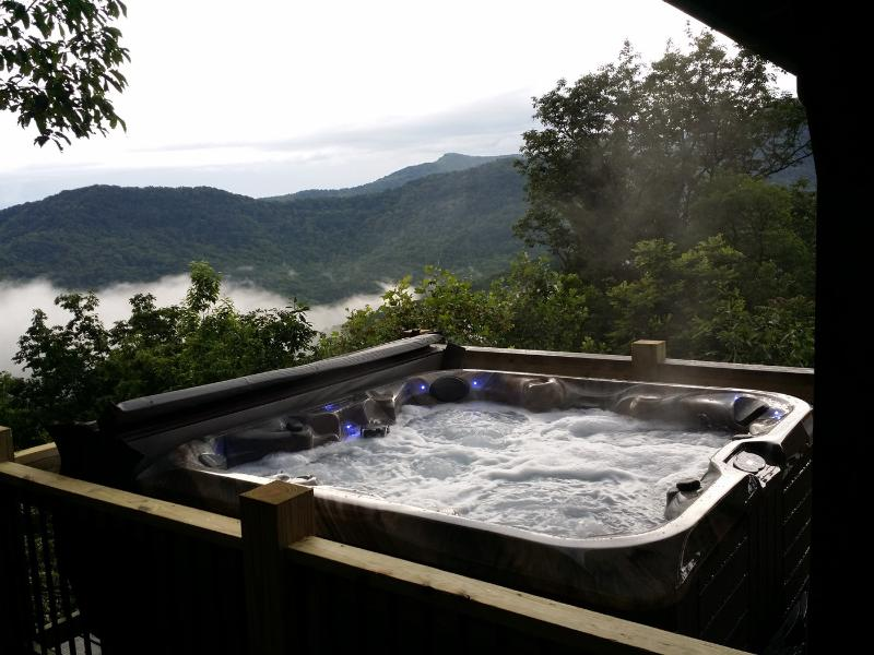 Soothing hot tub with soothing mountain views