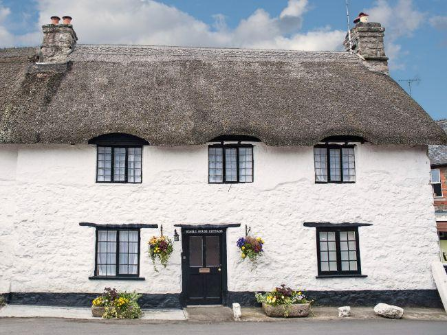 The cottage is in the heart of picture postcard Lustleigh
