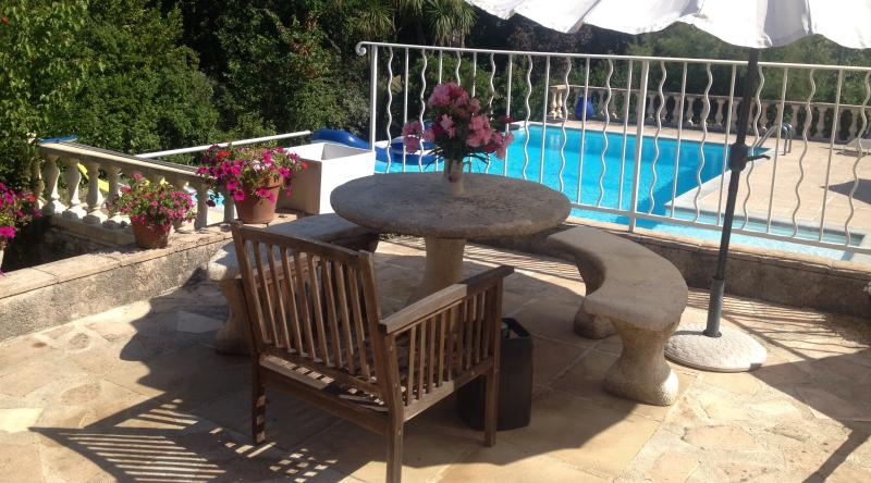 The house is set in beautiful grounds with a scented garden and terraces down to the pool