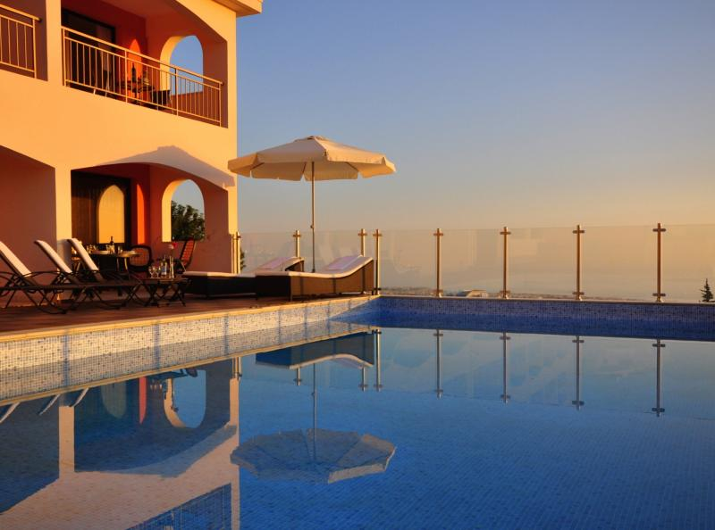 Set on the hillside in Tala Village with stunning panoramic sea views over the Coral Bay coast